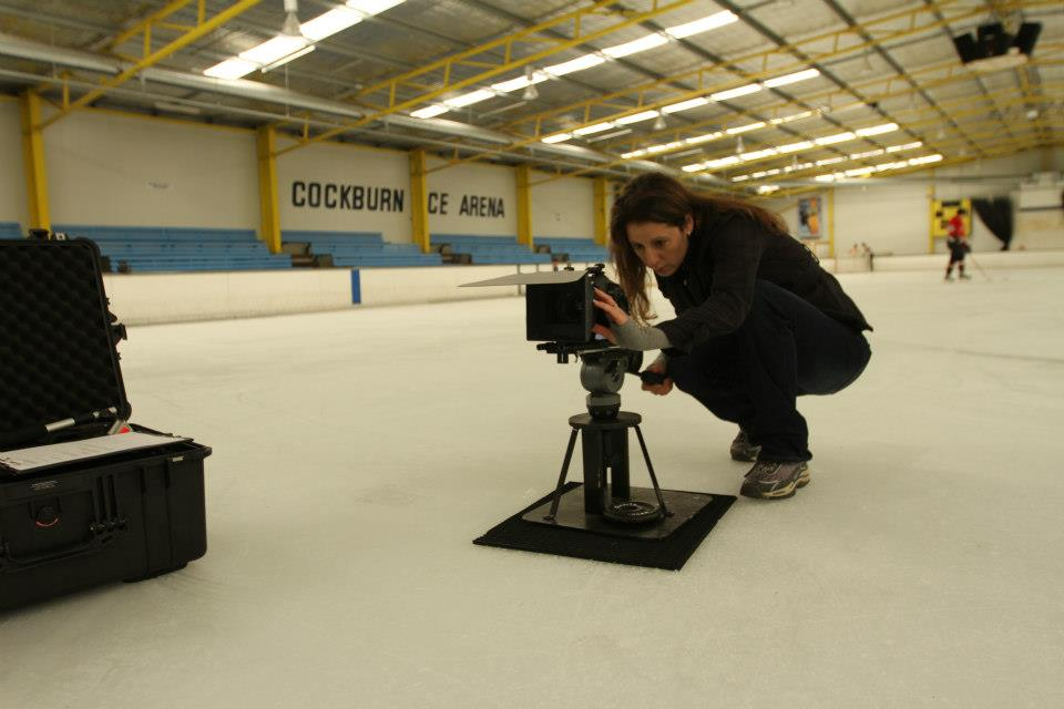 Kristen concentrating hard while she's videoing on the ice. For the Ice Skating Promotional video